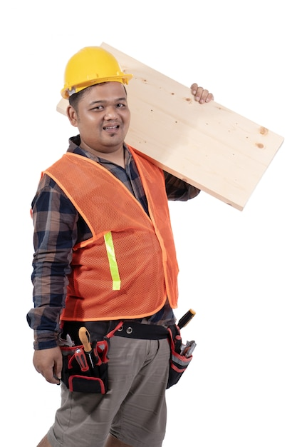 Portrait of constructor carrying wooden board with helmet and uniform Premium Photo