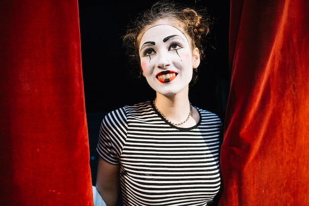 Portrait of a contemplated female mime artist Free Photo