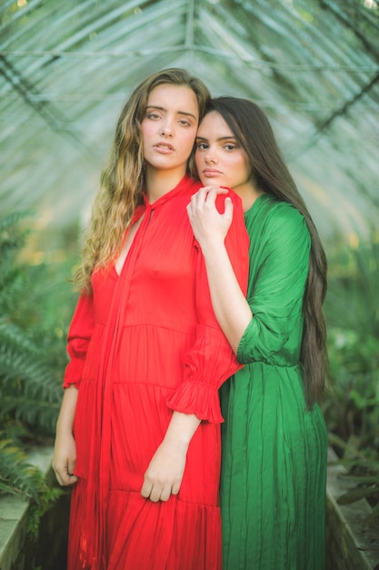 Portrait of contrasted coloured dresses Free Photo