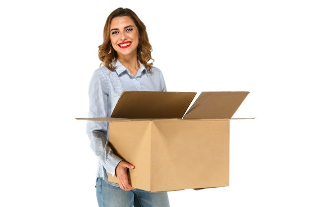 Portrait of cute attractive girl holding big cardboard box in her hands Free Photo