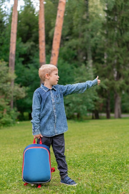 Portrait of cute boy with backpack. school. first grader Premium Photo