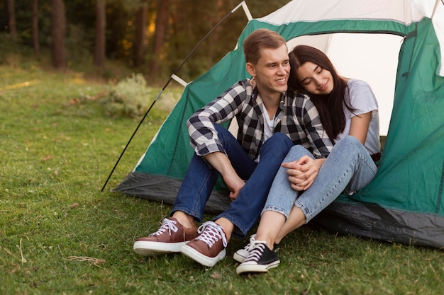 Portrait of cute couple relaxing outdoors Free Photo