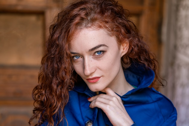 Portrait of cute red-haired girl , wavy hair and beautiful eyes Premium Photo