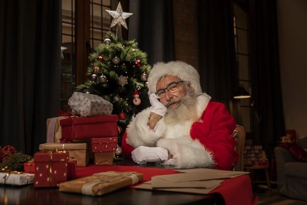 Portrait of cute santa claus thinking Free Photo