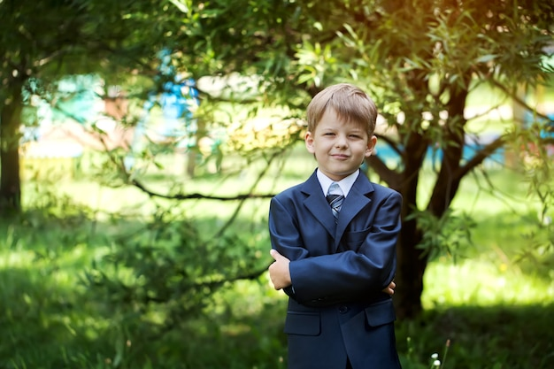 Portrait of cute school boy with backpack outdoors Premium Photo