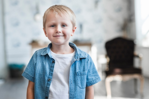 Portrait of a cute smiling blonde boy Free Photo