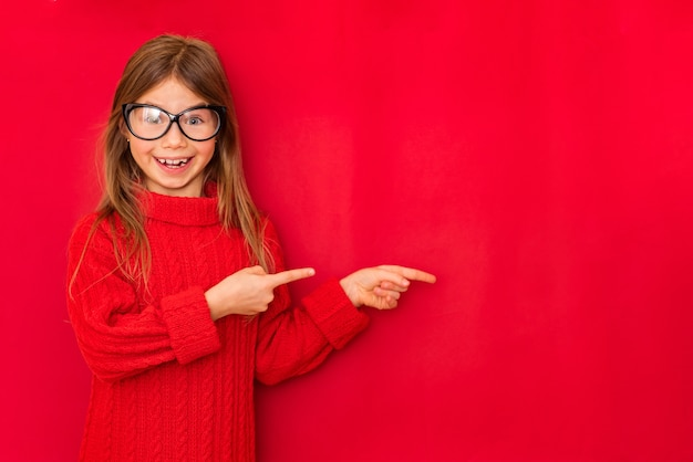 Portrait of cute smiling girl showing signs with her hands Premium Photo