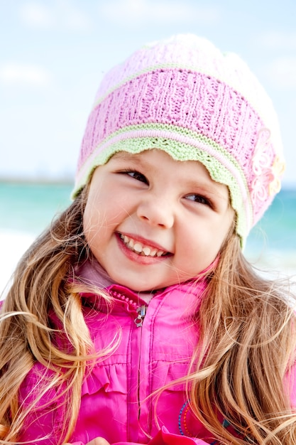 Portrait of cute young girl on the beach Premium Photo