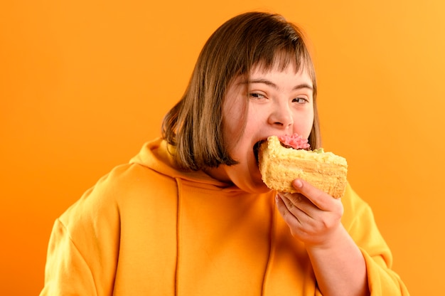 Portrait of cute young girl eating cake Premium Photo