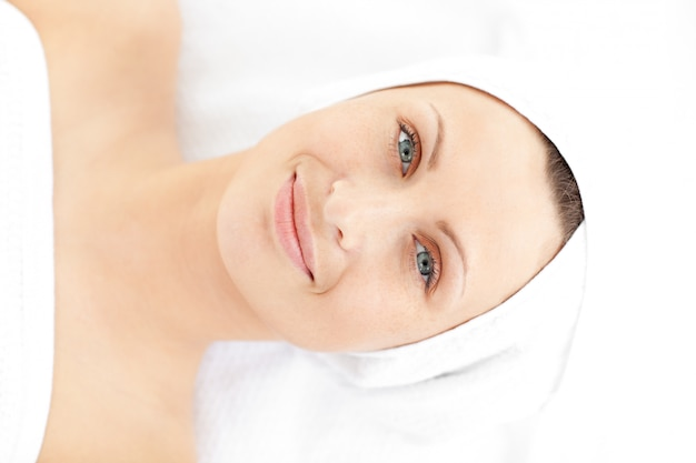 Portrait of a cute young woman lying on a massage smiling at the camera Premium Photo