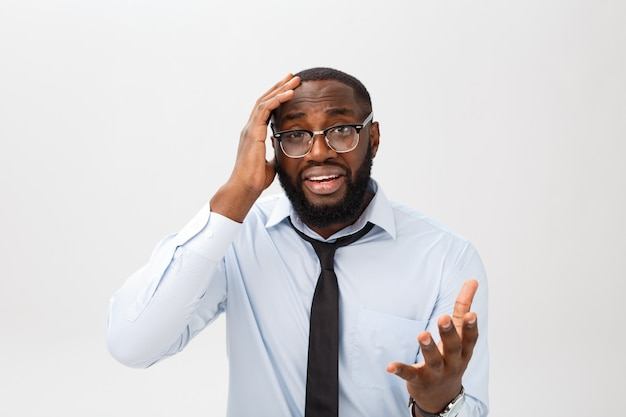 Portrait of desperate annoyed black male screaming in rage and anger tearing his hair out while feeling furious and mad with something. Premium Photo