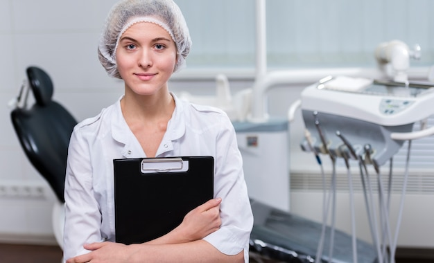 Portrait of doctor holding clipboard Free Photo