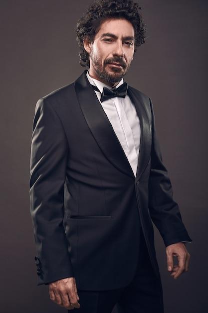 Portrait of elegant brutal fashion man in suit Premium Photo