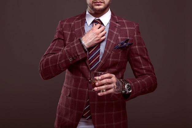 Portrait of elegant brutal man in a expensive suit Premium Photo