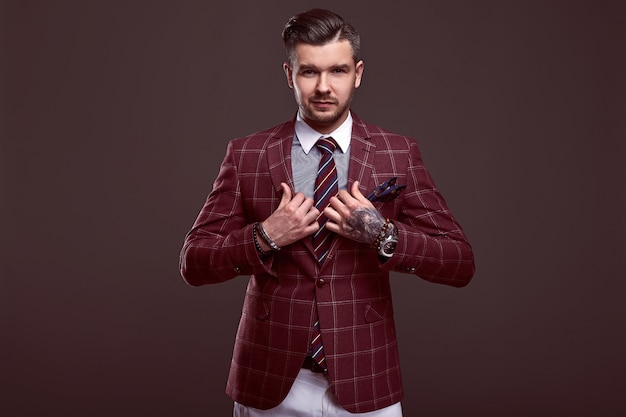 Portrait of elegant brutal man in a wool suit Premium Photo