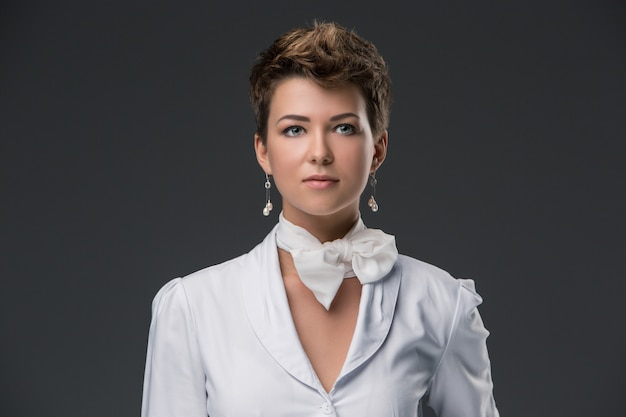 Portrait of an elegant young doctor in a white coat Free Photo