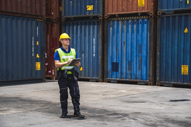 Portrait of engineer walking to checking the containers box Premium Photo