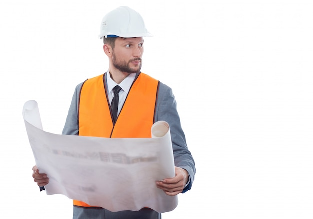 Portrait of engineer wearing in orange vest and white safety hat holding big drawing plan. Free Photo