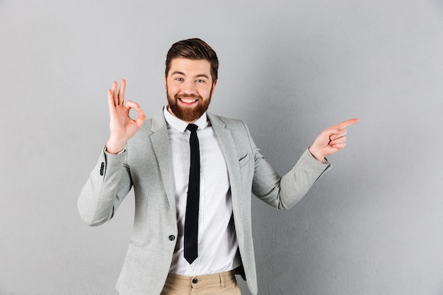 Portrait of an excited businessman dressed in suit Free Photo
