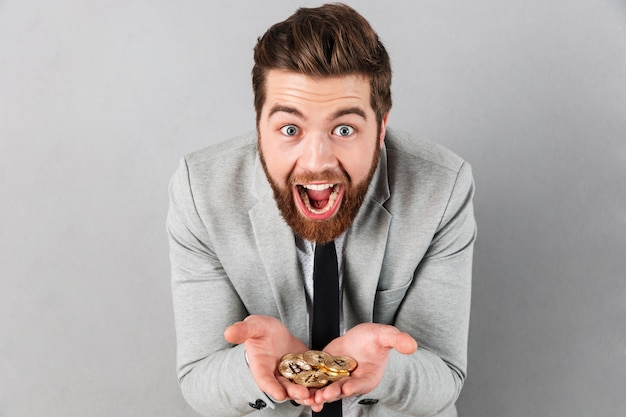 Portrait of an excited businessman Free Photo
