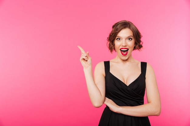 Portrait of an excited girl dressed in black dress Free Photo