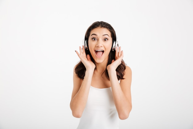 Portrait of an excited woman dressed in tank-top Free Photo