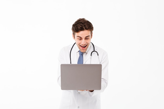 Portrait of an excited young male doctor Free Photo