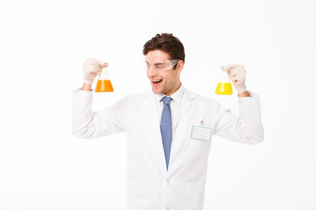 Portrait of an excited young male scientist Free Photo