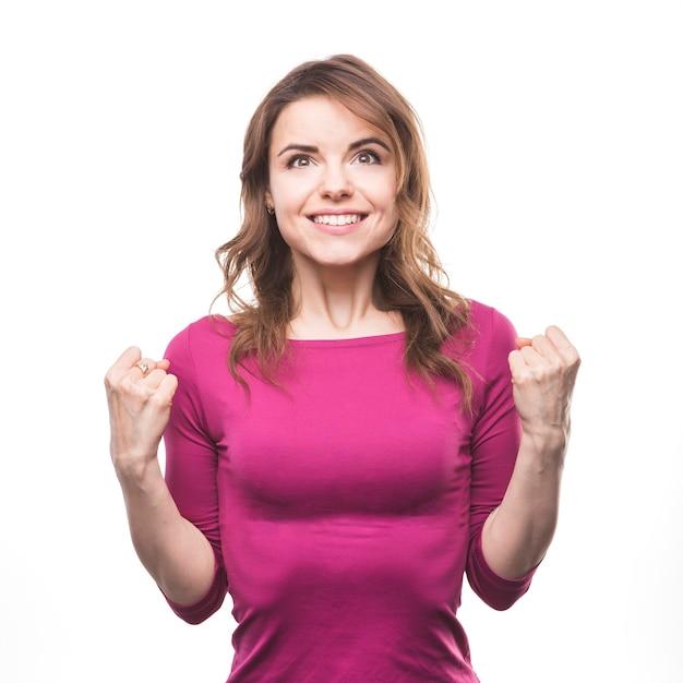 Ritratto di una giovane donna eccitata su sfondo bianco Foto Gratuite