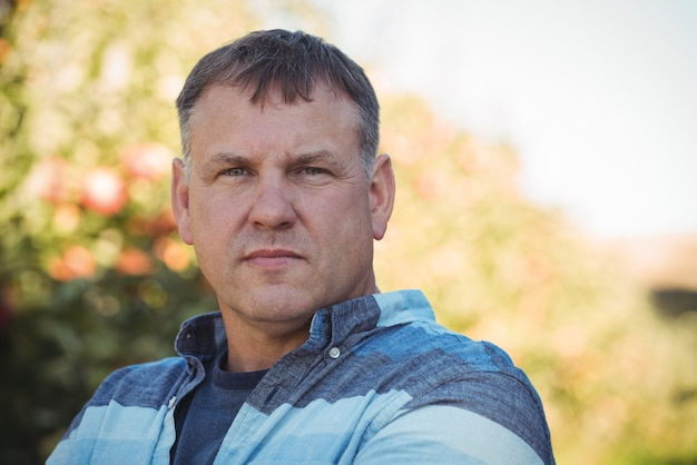 Portrait of farmer standing in apple orchard Free Photo