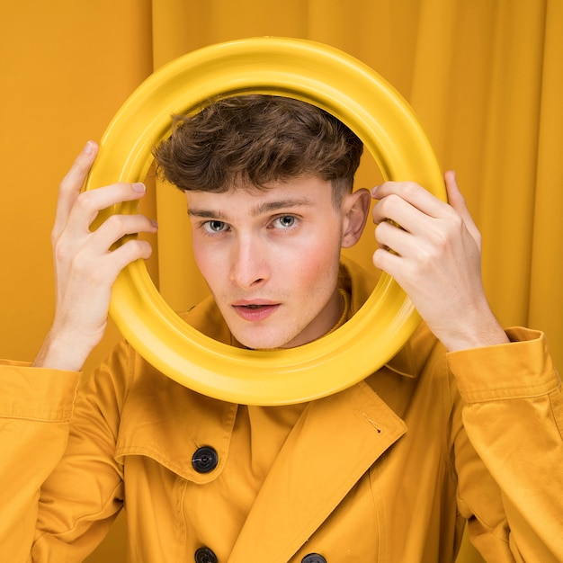 Portrait of fashionable boy with ring Free Photo