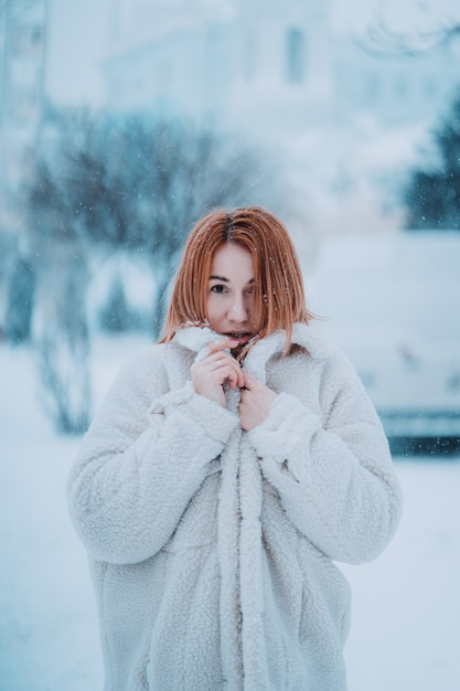 Portrait female model outside in first snow Free Photo