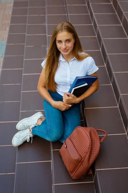 Portrait of female university student standing outside building Premium Photo