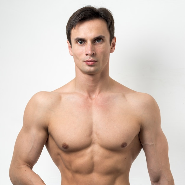 Portrait of a fit man posing Free Photo