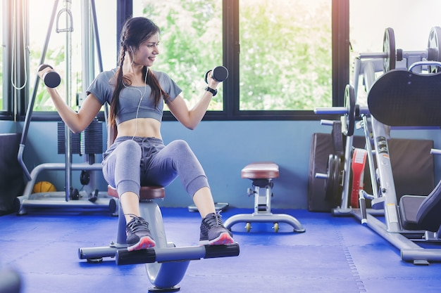 Portrait Of Fit Woman Muscular Bodybuilder Workout With