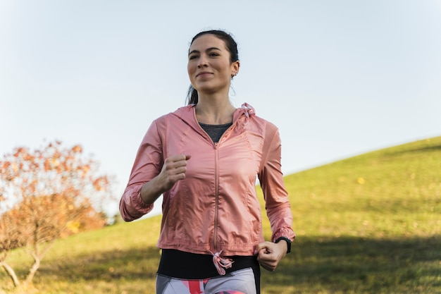 Portrait of fit woman running in the park Free Photo