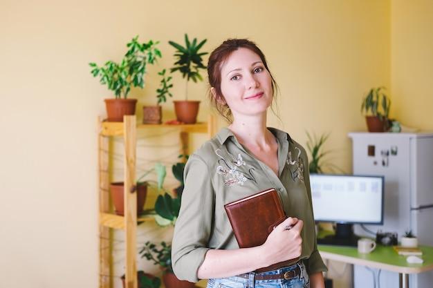 Portrait of a freelance entrepreneur woman working at home Premium Photo