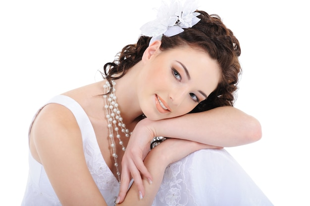 Portrait of fresh young woman in white wedding dress with curly hairs Free Photo