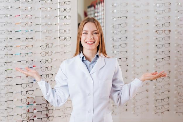 Portrait of friendly female optometrist Free Photo