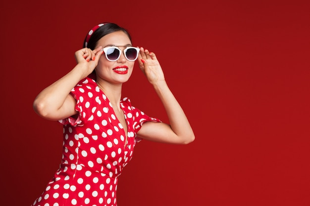 Portrait of a funny emotional young woman. pin-up style. Premium Photo