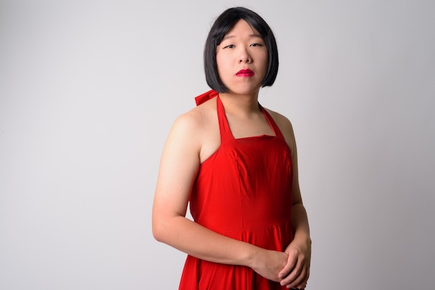 Premium Photo | Portrait of funny young gay asian man as transgender cross  dressing against white wall