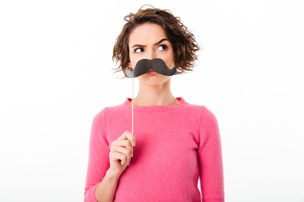 Portrait of a funny young girl holding paper moustaches Free Photo