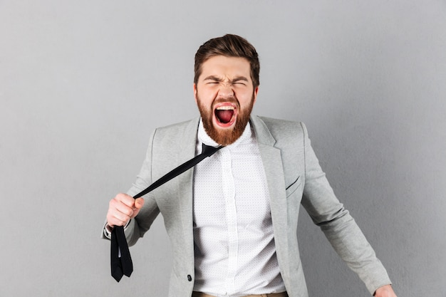 Portrait of a furious businessman dressed in suit Free Photo