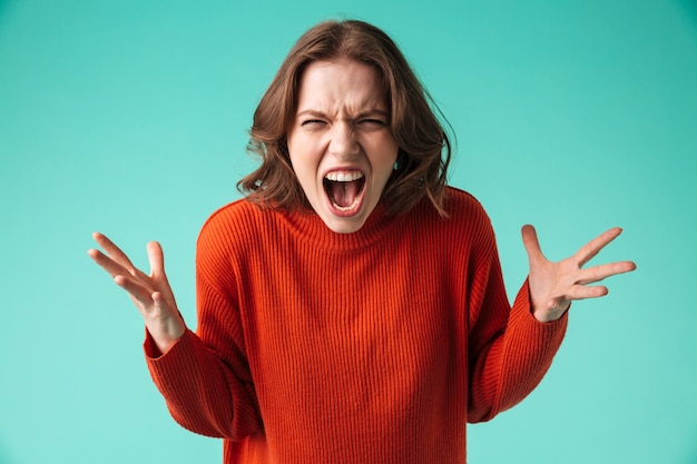 Portrait of a furious young woman dressed in sweater Premium Photo