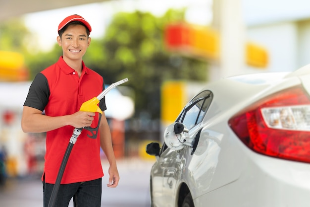 Portrait of gas station worker and service at the gas station Premium Photo