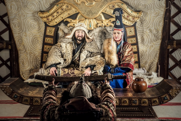 Portrait of genghis khan or chinggis khaan in warriors traditionally wearing typical mongolian dress culture of mongolia Premium Photo