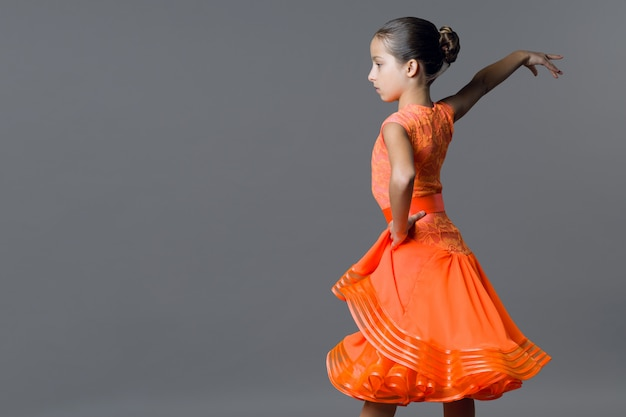 Portrait of a girl child dancer. sports ballroom dancing, latino. Premium Photo