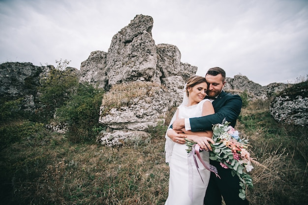 Portrait of a girl and couples looking for a wedding dress, a pink dress flying with a wreath of flo Premium Photo