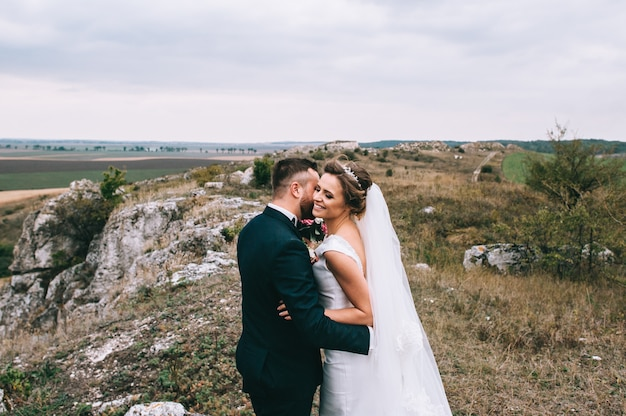 Portrait of a girl and couples looking for a wedding dress Premium Photo