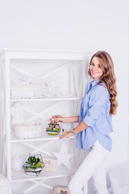 Portrait of a girl in the interior, florariums in the interior, interior solutions, business and home Premium Photo